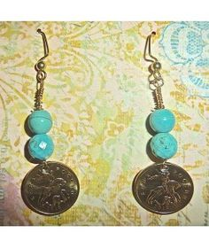 This simple, elegant pair of earrings were handcrafted from petite, modern 2012 Uncirculated Russian 10 Kopek coin and features natural turquoise $31.00  http://www.thesoulshoppe.com/earrings/2536-russia-2012-uncirculated-10-kopeks-with-natural-turquoise.html