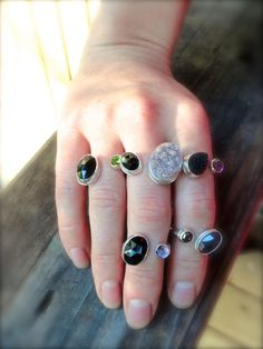 These are examples of rings I do for my customers that want to use multiple Birthstones. The design is a modern take on family rings. I have customers that say they receive compliments every time they wear their ring. I can create the ring with any two or three birthstones of your choice. Just convo me and we can get the ball rolling. It's a perfect birthday, mothers day, valentines day gift for your special one. Best,  Rachel