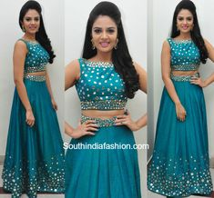 Sreemukhi in a mirror work lehenga and crop top photo