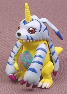 "Digimon gabumon PVC Figure, 2 1/2"" tall, 1999 Bandai, #73954,Button on Back Moves Arms"