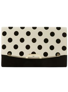 polka dot clutch mixed with the stripped dress. GORG! #JustFab #FashionWeek