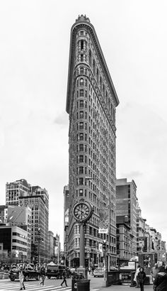 Flatiron Building - The Flatiron Building originally the Fuller Building is a triangular 22-story steel-framed landmarked building located at 175 Fifth Avenue in the borough of Manhattan New York City and is considered to be a groundbreaking skyscraper. Upon completion in 1902 it was one of the tallest buildings in the city at 20 floors high and one of only two skyscrapers north of 14th Street  the other being the Metropolitan Life Insurance Company Tower one block east. The building sits on…