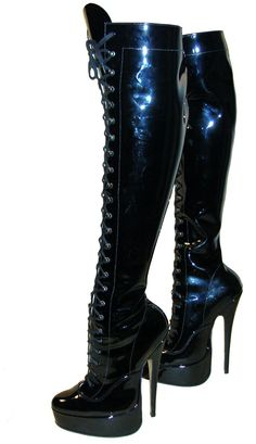 Classic shape fetish platforms with stiletto heels and eyelet and ski hook fastening.