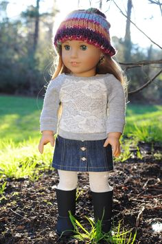 Top by Anick's Boutique, skirt by Royal Doll Boutique, hat by Closet4Chloe, and tights and boots are AG brand. American Girl