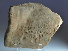 """Roman art, Aeneid incipit inscribed on roman tegula, 4th-5th century A.D. Roman art, Aeneid incipit, roman epigrapy, North African tegula sherd inscribed in late Roman cursive with beginning of the Aeneid """"arma virumqu[e ..."""" , the third line reads """"iactatu[s ..."""", the second line should come from line two of the Aeneid """"di uenique la["""", except for 'di', these letters and their sequence all occur in Aeneid I, 2–3, 'Lauinaque uenit   litora', 9.7 cm long. Private collection"""