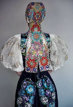 """pocarovna: """"This was the ball robe for the Slovak Opera Ball worn by Mrs. Tamara Heribanova, a known folk lover. What is so special about it? This ball is the most popular official ball in Slovakia, full of celebrities and politicians with extremely. Hungarian Embroidery, Folk Embroidery, Embroidery Stitches, Embroidery Patterns, Knitting Patterns, Folk Costume, Costumes, Costume Dress, Enchanted Doll"""