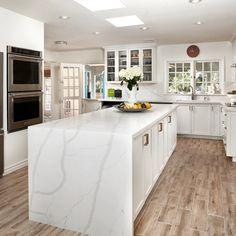 If you love the look of marble countertops, you'll love this stunning #quartz, Bertoli, that's designed to look just like it! A creamy white background with beautifully bold grey veining details makes Bertoli a truly memorable choice for #kitchencountertops that are timeless yet on-trend. #quartzthatlookslikemarble #arizonatile Marble Countertops, Kitchen Countertops, Quartz Slab, Data Sheets, White Quartz, Creamy White, Interior Walls, Arizona, How To Memorize Things
