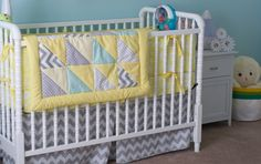 Love this yellow blanket with gray #chevron in a pale aqua nursery. #nurserydesign