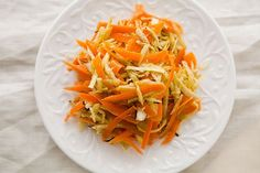 Winter Root Vegetable Slaw ~ It looks like cole slaw, but this shredded salad of root veggies -- carrots, radishes, parsnips and celery root -- is an excellent accompaniment to heavier winter foods.  ~ SimplyRecipes.com