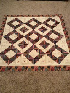 """This quilt is called Seven Sisters by Edyta Sitar from Laundry Basket Quilts. 5"""" Log cabin blocks."""