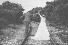 Humorous wedding photos on closed railway line.
