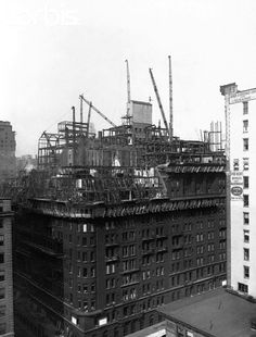 Vintage 1929, cranes work to disassemble the old Waldorf Astoria Hotel to make way for the Empire State Building, NYC, www.RevWill.com