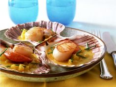 Jakobsmuscheln mit Currybutter und Ananas ist ein Rezept mit frischen Zutaten aus der Kategorie Muscheln. Probieren Sie dieses und weitere Rezepte von EAT SMARTER!