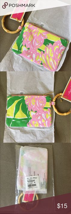 "NWT • LILLY PULITZER for Target Wristlet/ Clutch Lilly Pulitzer for Target Wristlet in Fan Dance.                       This colorful little clutch is perfect for carrying your smartphone, a bit of cash and some lip gloss—everything you need for a chic outing. The darling bamboo handle doubles as a bracelet and the exposed gold zipper adds a luxe twist to this 100% cotton wristlet. Dimensions: 7.5 "" H x 5.0 "" W Lilly Pulitzer for Target Bags Clutches & Wristlets"