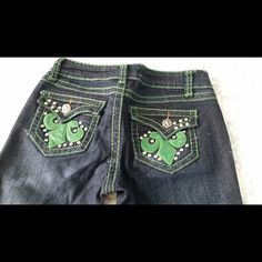 Miss Chic Fleur De Lis Rhinestone jeans Perfect condition, like new, green leather Fleur de Lis pockets with rhinestone accents. Flare style. Size 1 0-4. Miss Chic Jeans