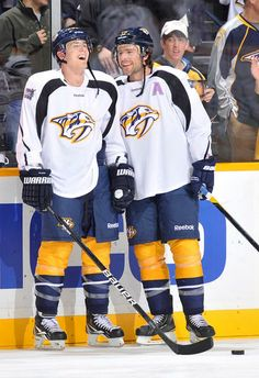 Predators Mike Fisher and Colin Wilson share a laugh during Hockey Fights  Cancer warm- ed6cc509f