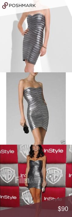 BCBGMaxazria Gunmetal Bandage Dress NWT! This dress is a dark silver/gun metal color. Form fitting and sexy! Size medium. BCBGMaxAzria Dresses Mini