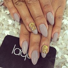 Almond grey acrylic nails with gold applications. | Find more inspiration at Instagram.com/lacquenailbar