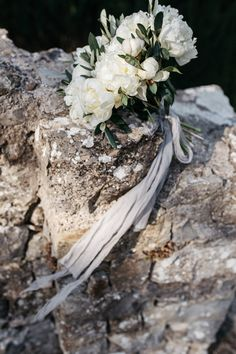 La Rosa Canina Firenze created Sara's simple bouquet of white peonies and olive leaves.