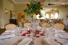 Red Rose Wedding Centerpiece in Eiffel Tower vase.