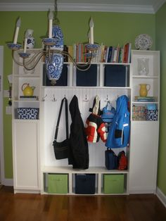 This is my new IKEA Hack that my hubby, Chris, made. thanks honey! It is an entryway/mudroom organizer that was made from Billy Bookcases from Ikea total - 2 of each type). I added the half doors for hidden storage and bought some storage bins from Target Kitchen Wall Storage, Ikea Storage, Kitchen Bins, Ikea Shelves, Hidden Storage, Garage Storage, Food Storage, Storage Ideas, Half Doors