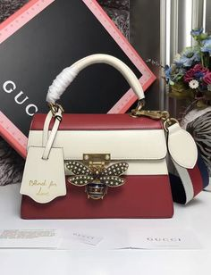Gucci Queen Margaret Multicolor Leather Top Handle Bag White Red. See more Gucci handbags at https://www.luxtime.su/gucci-bags #Top-HandleBags