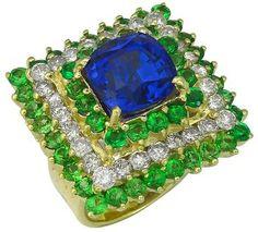 14k yellow gold ring. The ring features tanzanite, tsavorites and diamonds.