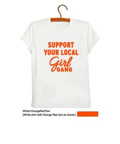 Support your local Girl Gang T Shirt Feminist Tee Shirt Womens TShirts Fangirl Feminism T Shirt Ladies Girls Tops Clothing Gifts  Hi Ya, welcome to FrogTee Coolest shirts are here for you.  This is a white t-shirt. 100% Cotton.  Shirt color: White Text/Print color: Black/Orange Red available  We have included a sizing chart within each listing. Please note that all of our tees are unisex fit. Available in size XS, S, M and L  ***Rolled up sleeves are for styling purposes only and ca...