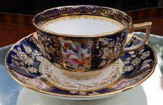 Antique Fine Porcelain : A fine Coalport bouquet moulded Tea Cup & Saucer
