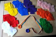 Button snake - thread felt shapes over the button...thread all the circles; thread all the pink shapes, etc