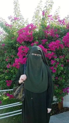 Muslimah Beauty in Niqab with Flowering Bush