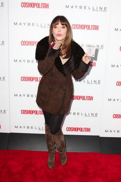 Celebrity guest Rose McGowan blows kisses on the step and repeat. #kissesforthetroops