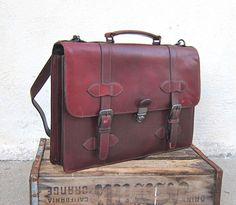 Vintage Rugged Italian Oxblood Hard Sided Leather Satchel Briefcase w/Shoulder Strap by Wilsons Leather. $85.00, via Etsy.