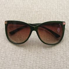 Sunglasses Green with gold hinge O by Oscar de la Renta sunglasses. Great frame shape! Small flaw on the bridge: chipped paint (see 3rd picture). O by Oscar de la Renta Accessories Sunglasses