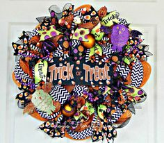 A personal favorite from my Etsy shop https://www.etsy.com/listing/246459119/trick-or-treat-wreath-halloween-owl-deco