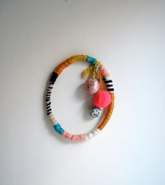 Yarn and Ball Wreath @Suzanne Senn Jensen - you could make this out of all your dream catcher supplies!