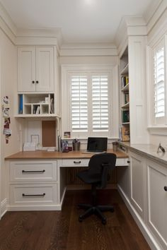 White plantation shutters in a home office.