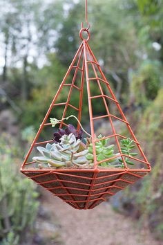 Hedge small hanging planter in sunset orange by HedgeOutdoor, $95.00