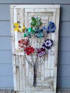 SOLD  Folk Artist Alan Moore junk art steel soda can flower bouquet. SOLD