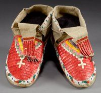A PAIR OF SIOUX QUILLED AND BEADED HIDE MOCCASINS c. 1900