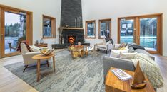 On cold & rainy days, there's no better place to be than sitting around the fire in the Welcome Lodge Luxury Living, Rainy Days, Modern Contemporary, Backdrops, Fire, Cold, Places, Beautiful, Home Decor