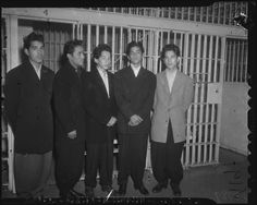 Zoot suit wearing pachucos detained by the police, ca. 1942. The Los Angeles press portrayed the Mexican American youths as criminals and juvenile delinquents, fanning the flames that led to the so-called Zoot Suit Riots in 1943.