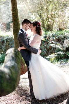 Broomhill Art Hotel Wedding Photo of bride and groom backlit with spring sunshine