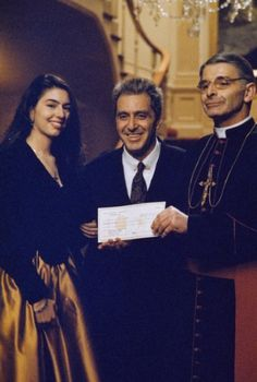 The Godfather: Part III (1990):  Sofia Coppola as Mary Corleone, Al Pacino as Michael Corleone and Donal Donnelly as Archbishop Gilday.