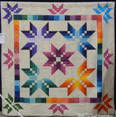 "Star Burst, 96 x 96"",  by Angela Mason, quilted by Pam Bowman.  Photo by Quilt Inspiration.  The pattern is by Missouri Star Quilt Company."