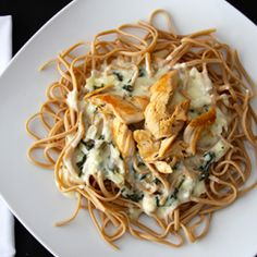 Spinach & Artichoke Alfredo Chicken is a tasty spin off your traditional Alfredo Sauce! An easy and delicious week night meal.