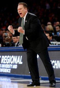 Tom Izzo reacts during the first half in a regional semifinal against Virginia at the NCAA men's college basketball tournament, Friday, March 28, 2014, in New York. (AP Photo/Frank Franklin II)