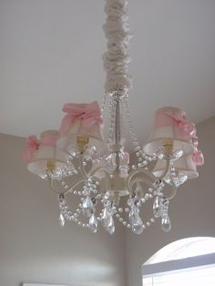Pink bows on chandelier shades - might be nice in my cottage....