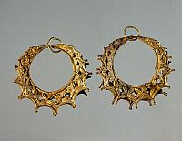 ARCHAEOLOGY.   Gold earrings from Tomb III of the Circle A of Mycenae (Greece). Goldsmith art, Mycenaean Civilization, 16th Century BC.
