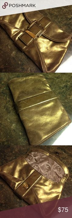 Michael Kors evening clutch Used twice in great condition, color is more of Bronze Michael Kors Bags Clutches & Wristlets